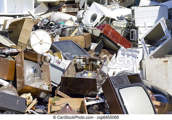 Dump the old broken appliances - csp6455068