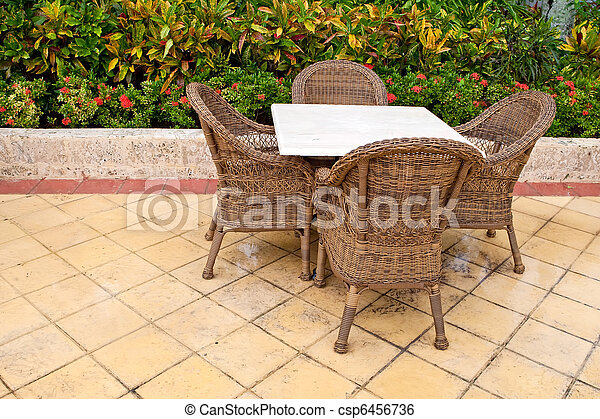 Brown wooden chairs an tables on patio - csp6456736