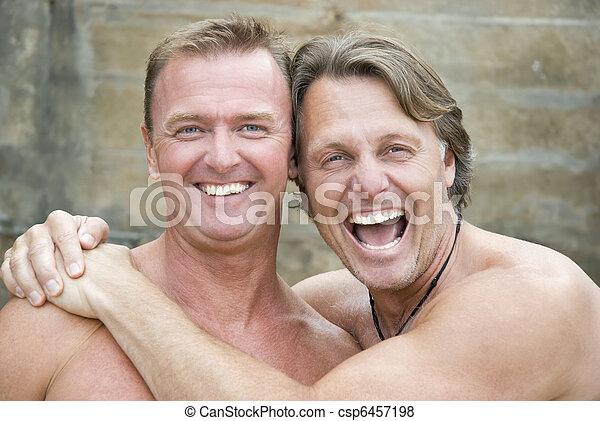 Happy gay couple cuddling. - csp6457198
