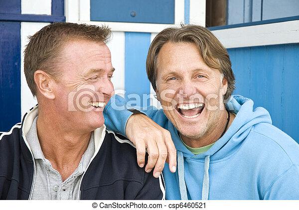 Two happy gay men cuddling. - csp6460521