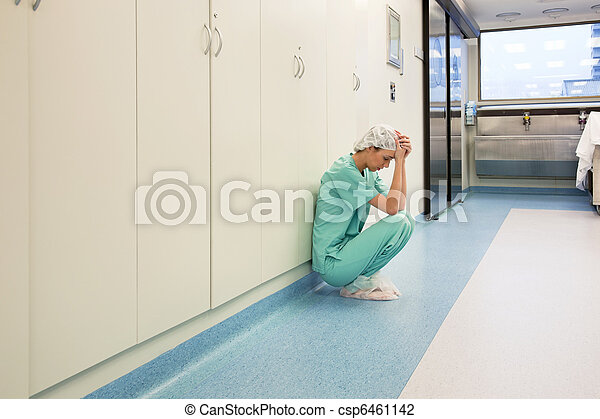 Upset surgeon sitting alone - csp6461142