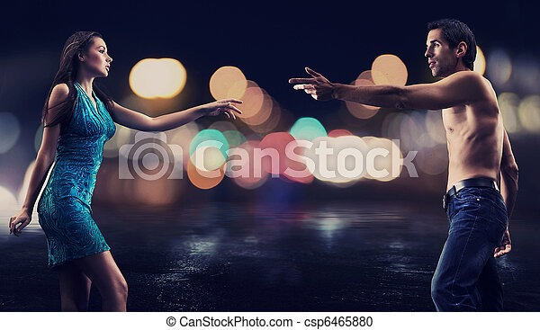 Gorgeous couple over night city street background - csp6465880