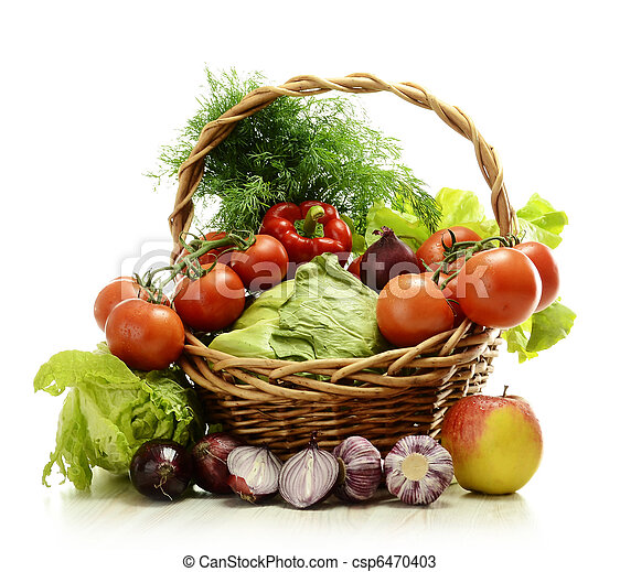Composition with raw vegetables and wicker basket - csp6470403