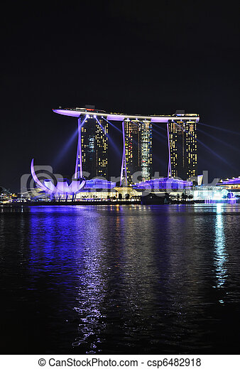 SINGAPORE - FEBRUARY 26: Marina Bay Sands hotel on Feb 26, 2011 in Singapore. Wonder Full show is the largest light and water spectacle in Southeast Asia - csp6482918