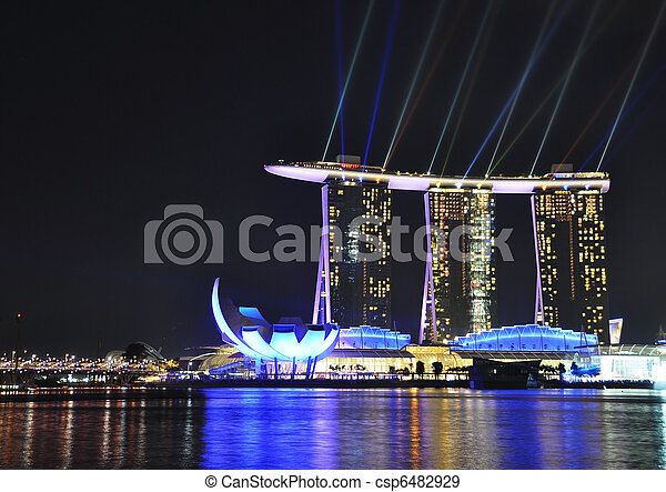 SINGAPORE - FEBRUARY 26: Marina Bay Sands hotel on Feb 26, 2011 in Singapore. Wonder Full show is the largest light and water spectacle in Southeast Asia - csp6482929