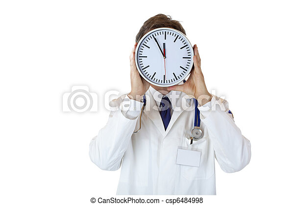Stressed doctor with clock in front of face as sign of time pressure - csp6484998