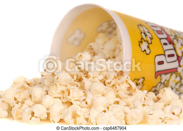 Container of popcorn with popcorn spilling out - csp6487904