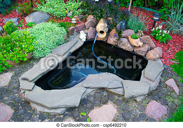 Pond on a lawn - csp6492210