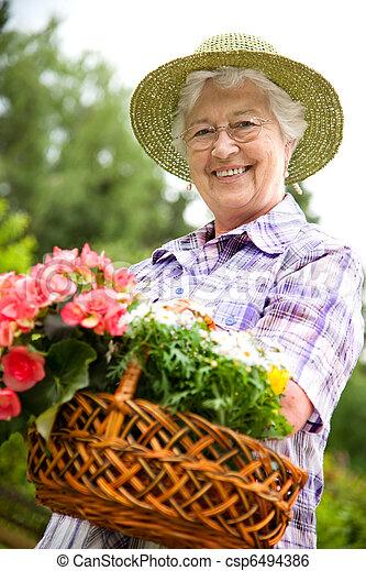 image de personne agee femme jardinage portrait joli personne csp6494386 recherchez. Black Bedroom Furniture Sets. Home Design Ideas
