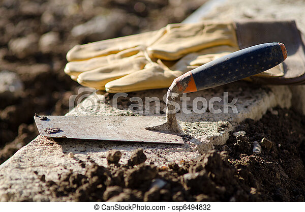 Trowel and protective gloves - csp6494832