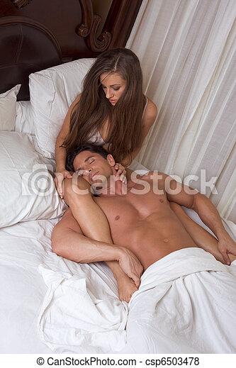 young heterosexual couple in bed - csp6503478