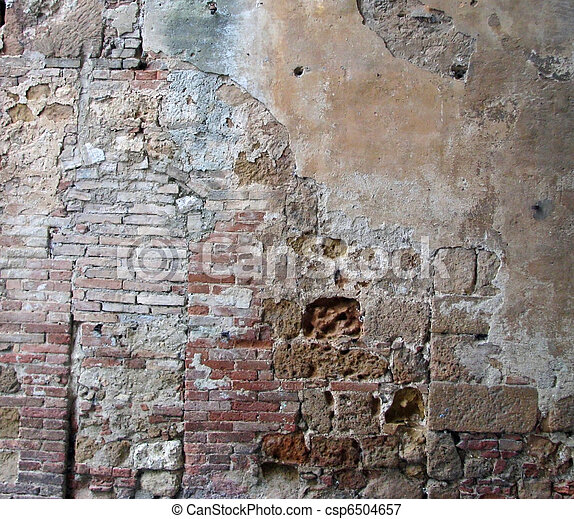 Vintage broken plaster and brick on a historic building in Italy.