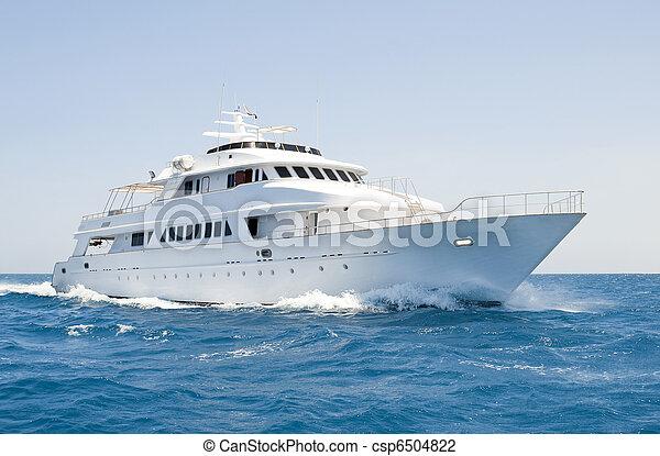Large motor yacht under way at sea - csp6504822