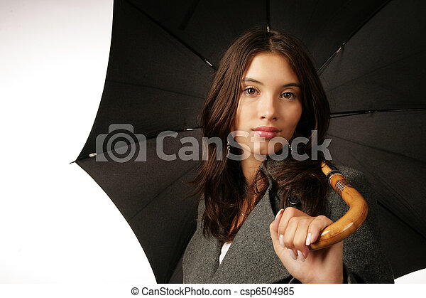 Beautiful young woman with black umbrella over white background - csp6504985