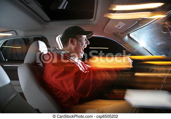 Man driving car at night, speeding - csp6505202