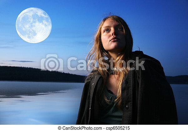 Beautiful young woman at night outdoors at lake - csp6505215