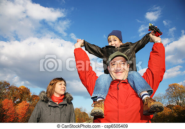 Young family in autumn park outdoors - csp6505409