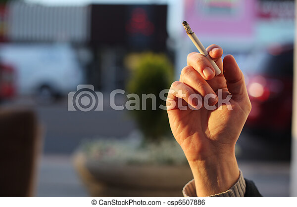 Hand with smoking cigarette - csp6507886