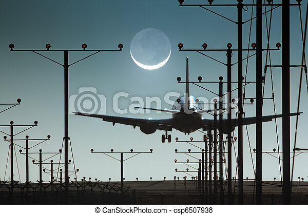 Plane landing in airport at night - csp6507938