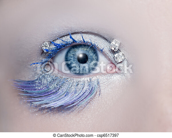 Blue eye macro closeup winter makeup jewels diamonds - csp6517397