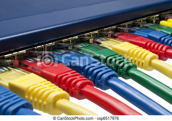 Multi color ethernet network plugs connected to a router / switch - csp6517976