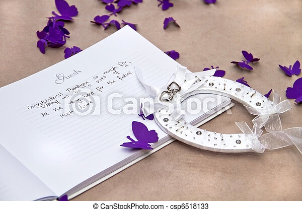Opened Wedding Guest Book with a Good Luck Horseshoe - csp6518133
