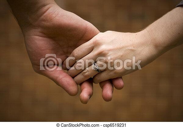 Caucasian couple holding hands - csp6519231
