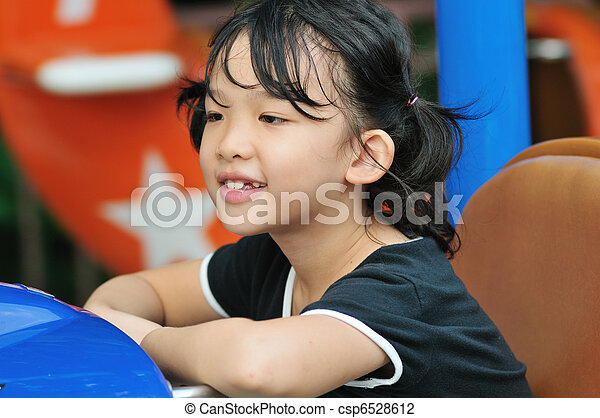 Asian kid in amusement park - csp6528612