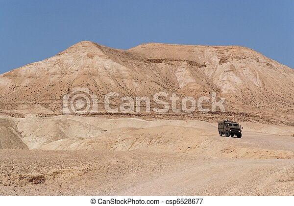 Israeli army Humvee on patrol in the Judean desert - csp6528677