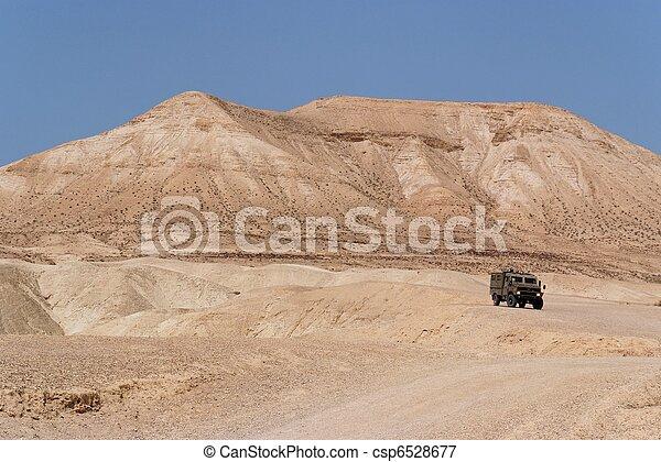 Israeli army Humvee on patrol in the Judean desert  - csp6528677