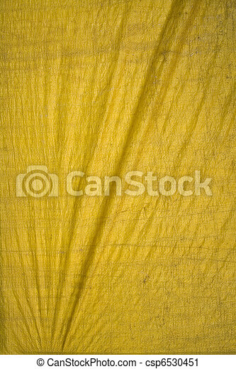 Yellow tarpaulin with folds - csp6530451