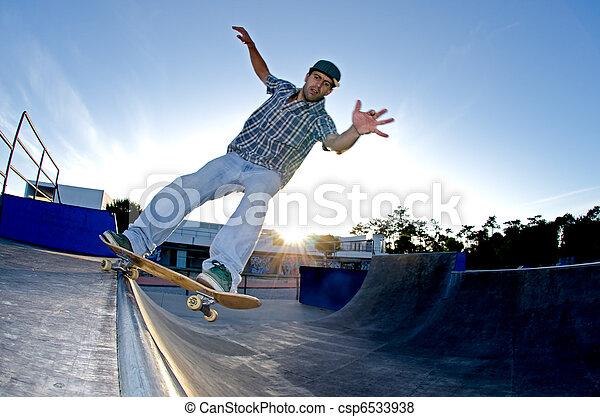 Skateboarder on a grind - csp6533938