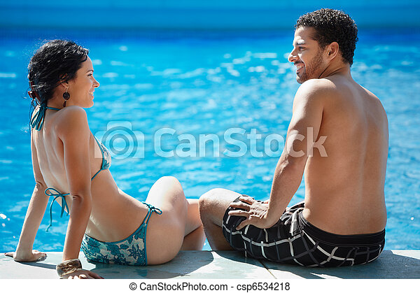 young couple doing honeymoon in resort - csp6534218