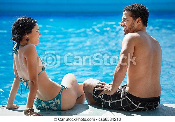 young couple doing honeymoon in resort - csp6534218