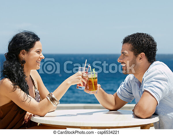 happy husband and wife toasting with cocktails - csp6534221