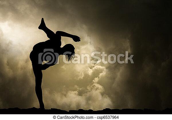Man Practices Martial Arts Background - csp6537964
