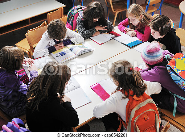 happy kids with  teacher in  school classroom - csp6542201