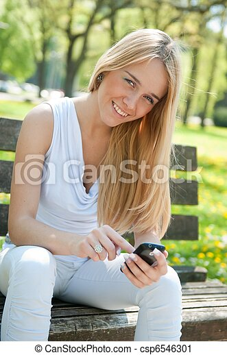 Mobile communication - smiling teenager - csp6546301
