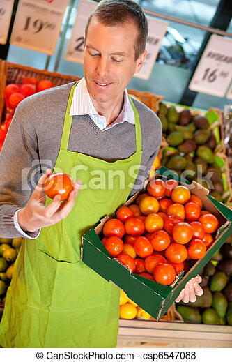 Grocery Store Clerk with Tomatoes