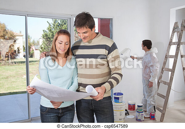 Couple going through house plan - csp6547589