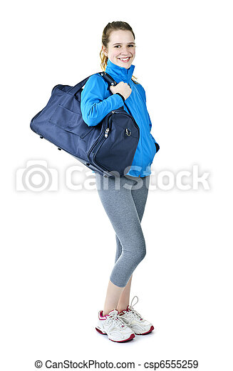 Athletic girl with gym bag ready for workout - csp6555259