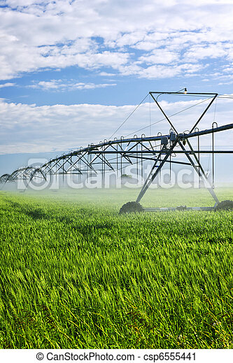 Irrigation equipment on farm field - csp6555441
