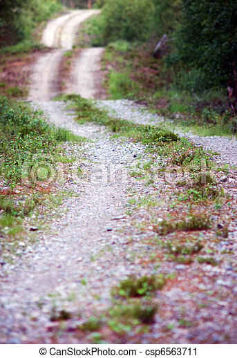 Winding dirt road - csp6563711