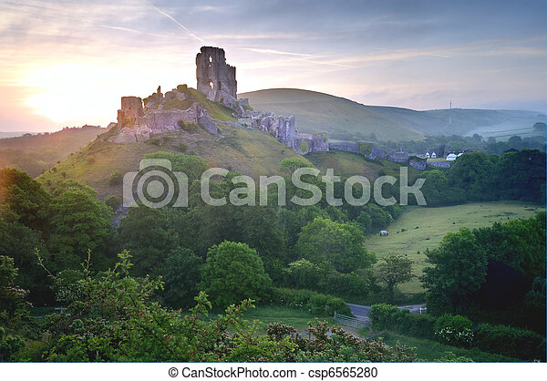 Beautiful dreamy fairytale castle ruins against romantic colorful sunrise - csp6565280