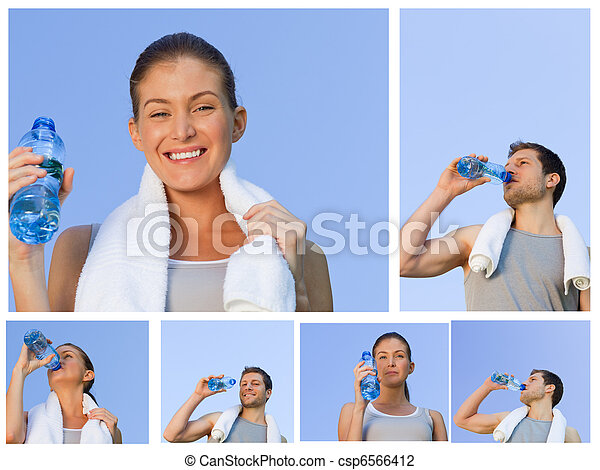 Young couple resting and drinking some water after jogging - csp6566412