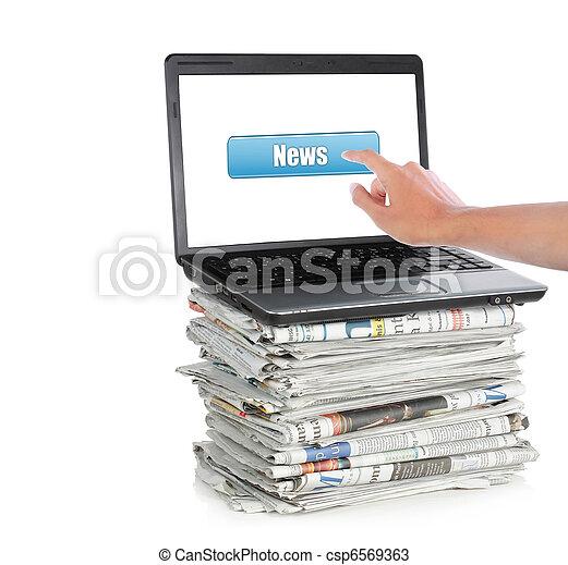 News on a laptop computer - csp6569363