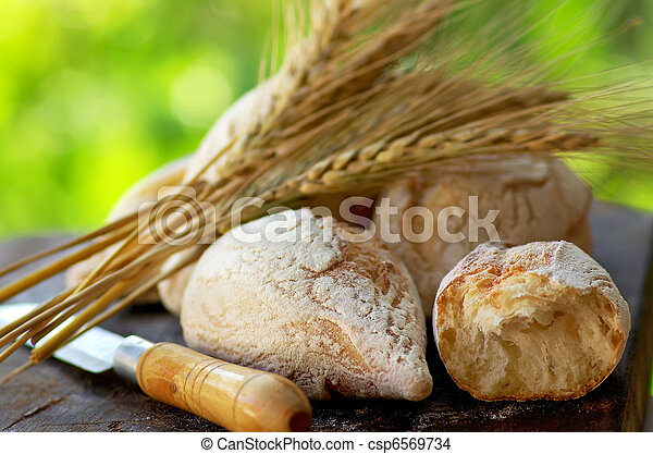 Portuguese bread and spikes of wheat. - csp6569734