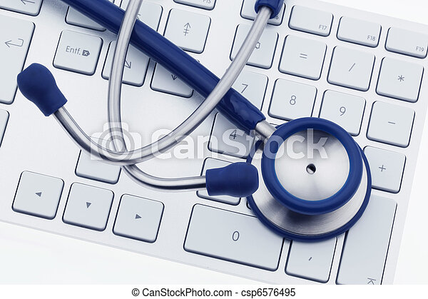 Stethoscope on computer keyboard - csp6576495