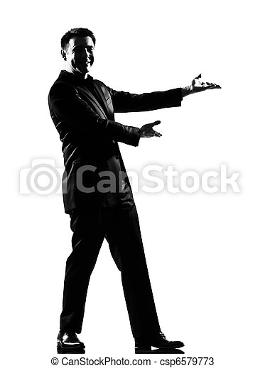 silhouette  man  showing gesture introducing presentation - csp6579773