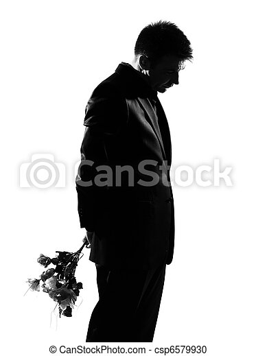 silhouette  man offering flowers - csp6579930